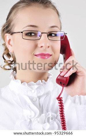 Young business woman that she listens to talk on the phone. Pleasant conversation