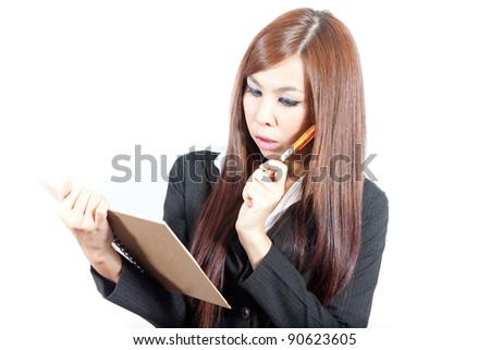 Young business woman thinking with her note and pen