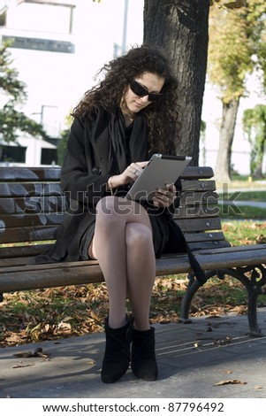 Young Business Woman Uses Tablet PC In The Park