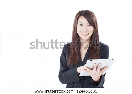 Young business woman using tablet computer, isolated on white background