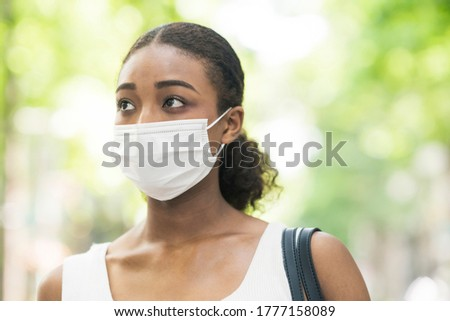 Young business woman wearing summer clothes and wearing a mask