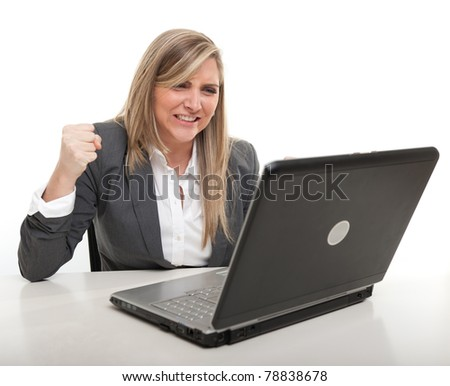 Young business woman with an annoyed expression looking at her computer