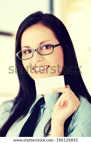 Young business woman with business card