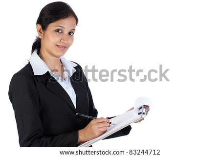 Young business woman with clipboard against white background