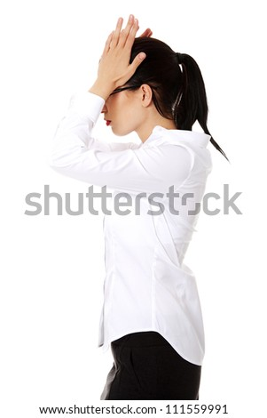 Young business woman with headache , isolated on white background