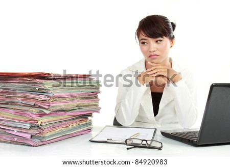 young business woman with laptop and many paper stressed at work
