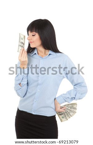 Young business woman with pile of money