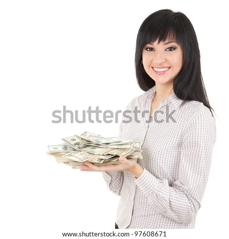 Young business woman with pile of money - stock photo