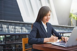 Young business woman working in office with documents. Portrait of smiling pretty young business woman in meetingroom.