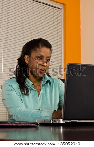 Young business woman working on a laptop computer