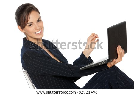 Young business woman working on laptop, isolated on white background