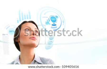Young business woman working with innovative virtual interface