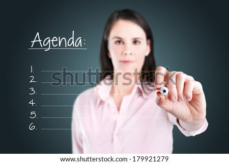 Young business woman writing blank agenda list.