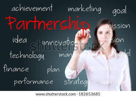 Young business woman writing partnership concept.