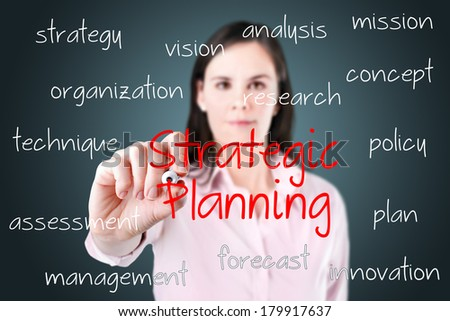 Young business woman writing strategic planning concept.