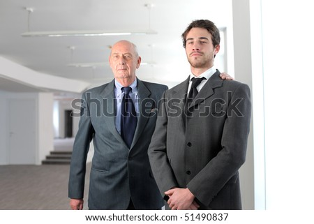 Young businessman and satisfied senior businessman