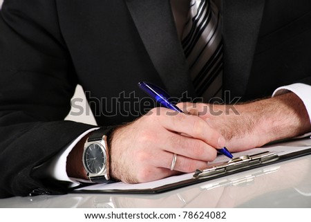 Young businessman at working and signing a contract - stock photo