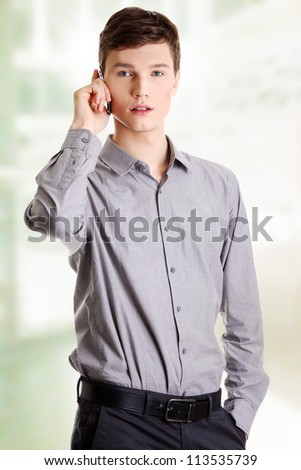 Young businessman calling by mobile phone.