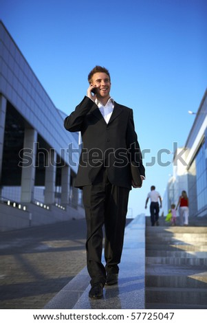 Young businessman calling on mobile phone, outdoor.