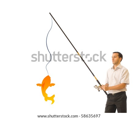 Young businessman catching the golden fish - stock photo