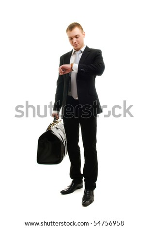 Young businessman checking his watch. Isolated over white