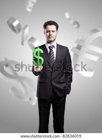 Young  businessman chooses a green US dollar sign - stock photo