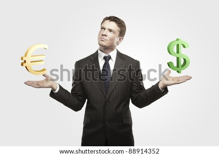 Young  businessman chooses a green US dollar signs.On a gray background