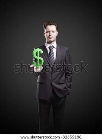 Young  businessman chooses a US dollar sign