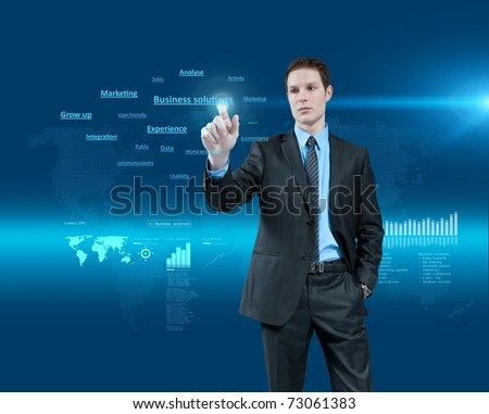 Young businessman choosing business solutions in holographic virtual reality interface. Future collection. One of a series. - stock photo