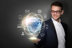 young businessman connected through cellphone on his hand. virtual hightech concept