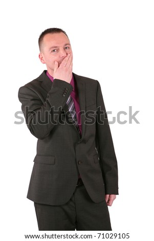 Young businessman covering his mouth with his hand, isolated on white - stock photo