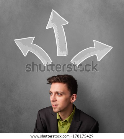 Young businessman deciding with sketched arrows above his head