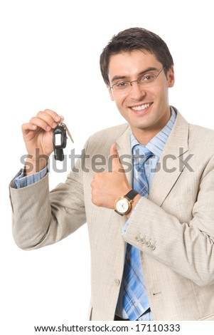 Young businessman demonstrating keys of new car, isolated on white