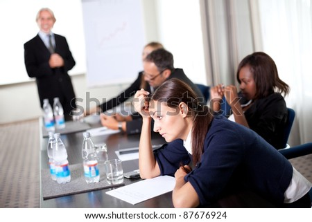 Young businessman discussing work with his colleagues at a meeting room