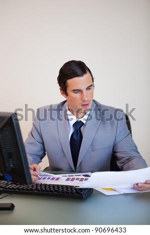 Young businessman doing paperwork