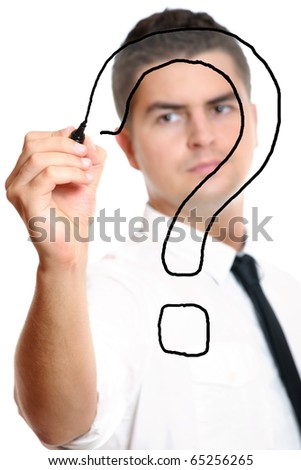 Young businessman drawing a big question mark over white background