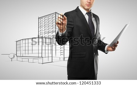 young businessman drawing house project