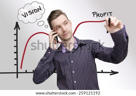 Young businessman drawing profit chart, while talking on phone. Young adult having vision how to make profit