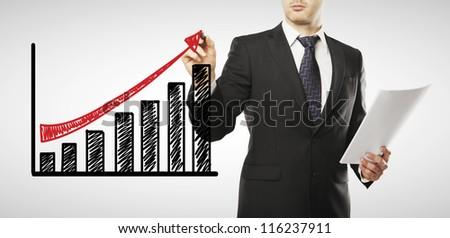 young businessman drawing profit scheme