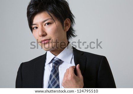 young businessman dressed in the suit