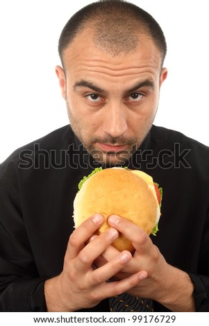 Young businessman eating hamburger over white