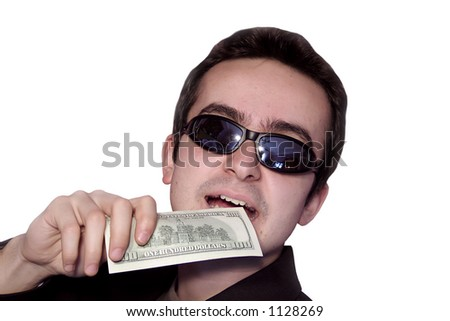 Young businessman eating 100$. Isolated on white