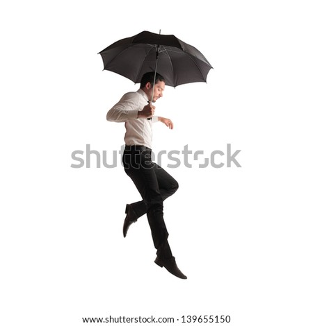 young businessman flying with umbrella