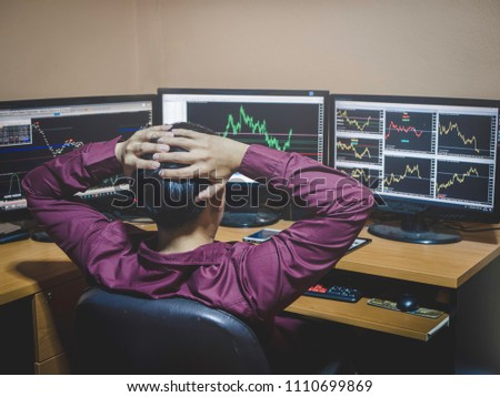 Young businessman found pressure and during thinking in the forex stock market