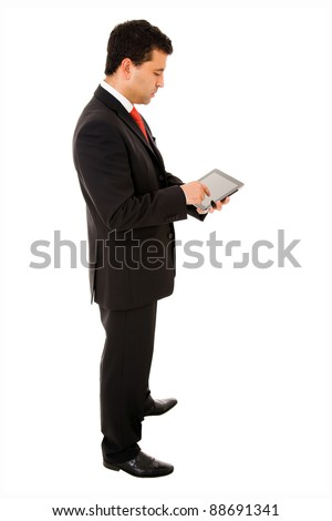 Young businessman full body using a tablet pc on white background