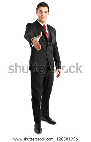 Young businessman full length offering handshake