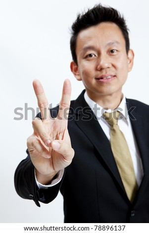 young businessman giving hand symbol isolated