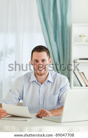 Young businessman happy about a letter