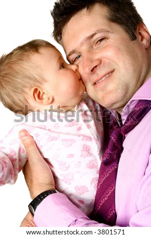 Young businessman having a cuddle with his baby girl, receiving a quick kiss on cheek, isolated on white.