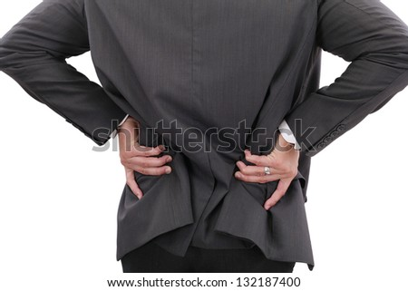 Young businessman having some lower back pain